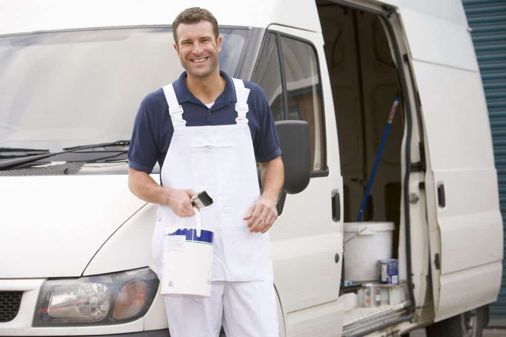 house Painter standing with van smiling