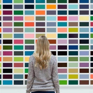 Woman standing in front of huge Color chart Board