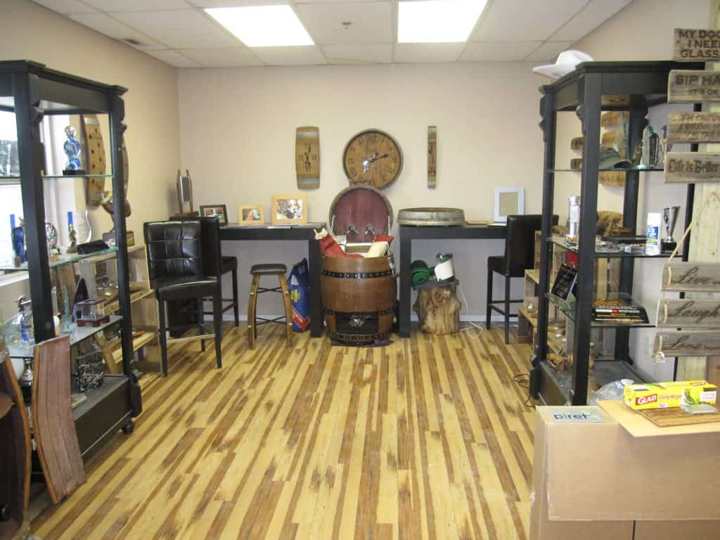 Before and after pictures of First Class Engraving Showroom