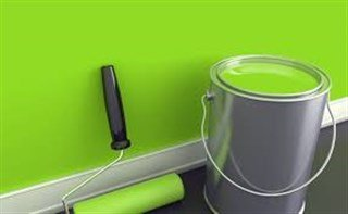 Picture of Green colored wall paint and paint bucket